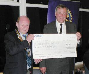 Golf Club captain David Erskine (right) receives cheque for £700